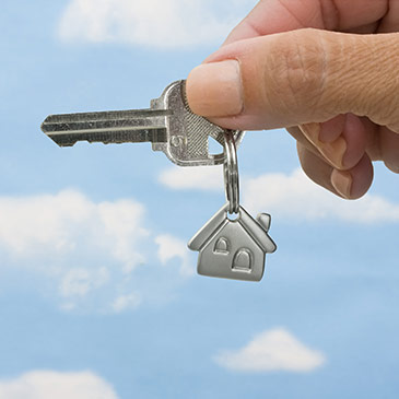 Image of homeowners holding a house key.